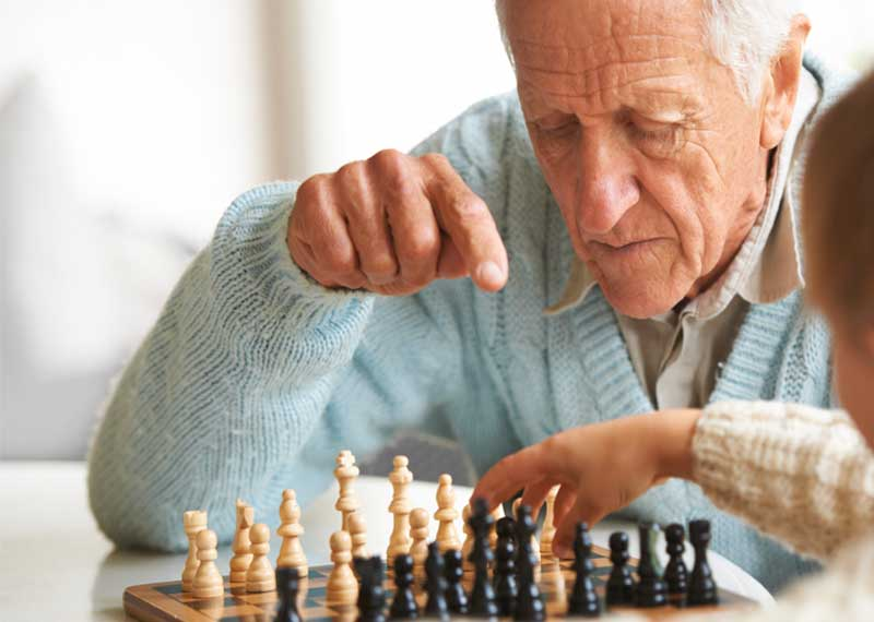 older man playing a game of chess