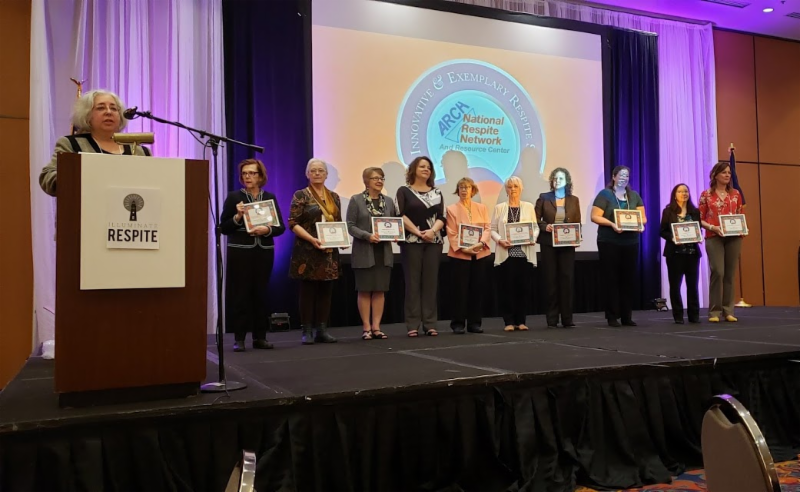 Mary Chaput, program director for the Department of Aging and Disabilities (pictured 5th from the right) is presented the award at the recent ARCH conference.